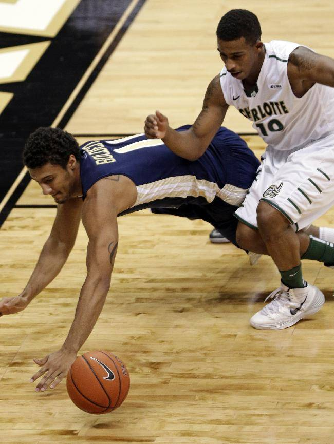 Georgia Tech's Chris Bolden (11) and Charlotte's Denzel Ingram (10) chase a loose ball during the second half of an NCAA college basketball game in Charlotte, N.C., Sunday, Dec. 29, 2013. Georgia Tech won 58-55