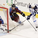 Winnipeg Jets' Evander Kane, right, tries to loop around to take the shot but Colorado Avalanche's Semyon Varlamov (1) made the save, during the first period of an NHL hockey game on Monday, March 10, 2014 in Denver The Associated Press
