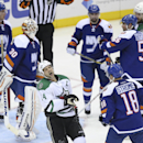 Dallas Stars left wing Jamie Benn (14) reacts after missing a scoring opportunity on New York Islanders goalie Chad Johnson (30) during the third period of their NHL hockey game, Saturday, Oct. 25, 2014, in Uniondale, N.Y. The Islanders won, 7-5 The Assoc