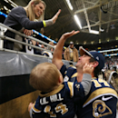 St. Louis Rams quarterback Shaun Hill high-fives his wife, Ashton, as he holds their son, Theo, 9 months, after an NFL football game against the Denver Broncos, Sunday, Nov. 16, 2014, in St. Louis The Associated Press