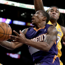 Phoenix Suns guard Eric Bledsoe, left, goes to the basket past Los Angeles Lakers center Jordan Hill during the second half of an NBA basketball game in Los Angeles, Tuesday, Dec. 10, 2013 The Associated Press