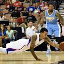 LAS VEGAS, NV - OCTOBER 18:  Matt Barnes #22 of the Los Angeles Clippers saves the ball from going out of bounds in front of Wilson Chandler #21 of the Denver Nuggets during their preseason game at the Mandalay Bay Events Center on October 18, 2014 in Las Vegas, Nevada. NOTE TO USER: User expressly acknowledges and agrees that, by downloading and or using this photograph, User is consenting to the terms and conditions of the Getty Images License Agreement.  (Photo by Ethan Miller/Getty Images)