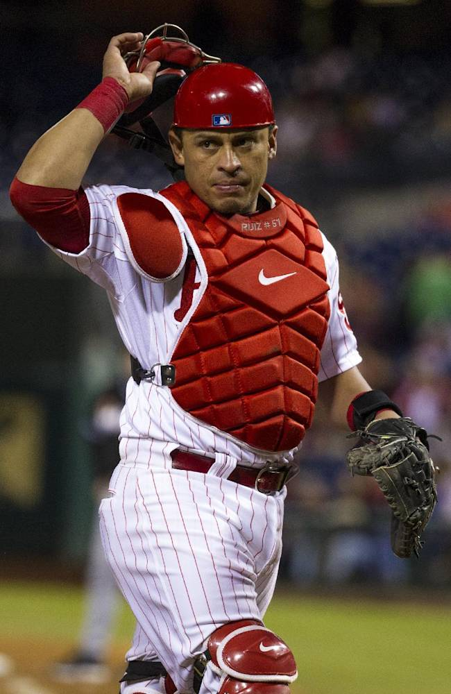Philadelphia Phillies catcher Carlos Ruiz  looks toward the Marlins dugout during the eighth inning of a baseball game, Tuesday, Sept. 17, 2013, in Philadelphia.  The Phillies win 6-4