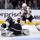 Chicago Blackhawks left wing Patrick Sharp, right, tries to get a shot in on Los Angeles Kings goalie Jonathan Quick during the first period of an NHL hockey game, Wednesday, Jan. 28, 2015, in Los Angeles The Associated Press