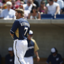 Milwaukee Brewers' Mark Reynolds flips his bat and helmet away after fouling out against the San Francisco Giants during the second inning of an exhibition baseball game, Tuesday, March 25, 2014, in Phoenix. The Giants defeated the Brewers 5-4 The Associa