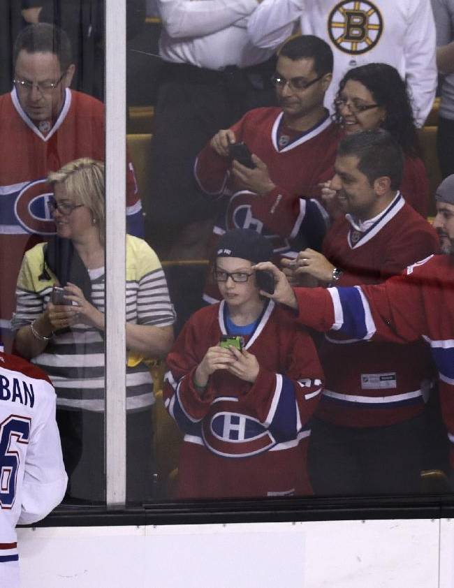 Montreal Canadiens fans photograph defenseman P.K. Subban (76) during a warmup before facing the Boston Bruins in Game 5 of the second-round of the Stanley Cup hockey playoff series in Boston, Saturday, May 10, 2014