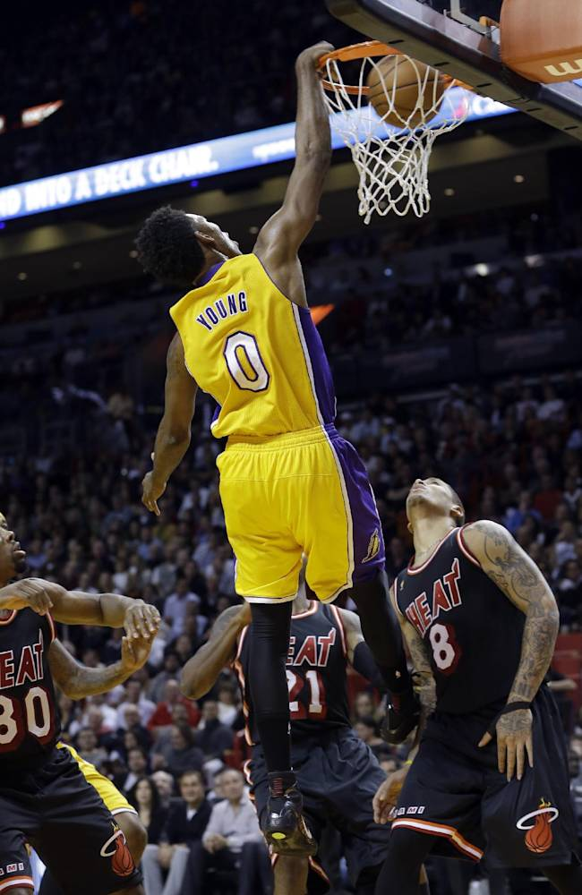 Los Angeles Lakers forward Nick Young (0) scores against the Miami Heat  during the third quarter of an NBA basketball game in Miami, Thursday, Jan. 23, 2014. The Heat won 109-102
