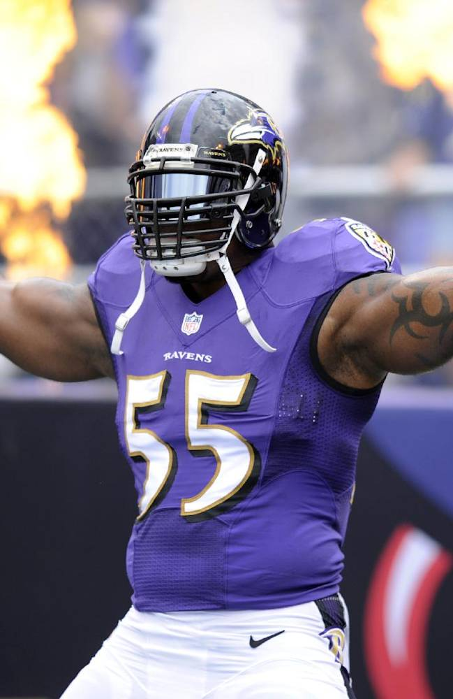 In this file photo from Sept. 22, 2013, Baltimore Ravens outside linebacker Terrell Suggs is introduced before an NFL football game in Baltimore. The Ravens announced, Monday, Feb. 17, 2014, Suggs signed a four-year extension with the team. His extension with saves the Ravens salary cap room and puts the linebacker in position to finish his career in Baltimore. Suggs, 31, signed a six-year deal in 2009 that expired after the 2014 season. Now he's signed through 2018