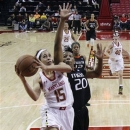 Maryland guard Chloe Pavlech (15) shoots past Miami forward Keyona Hayes in the first half of an NCAA college basketball game in College Park, Md., Thursday, Jan. 10, 2013. (AP Photo/Patrick Semansky)