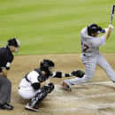 Detroit Tigers' Jhonny Peralta (27) hits a double as Miami Marlins catcher Koyie Hill, center, and home plate umpire Tom Hallion, left, look on during the sixth inning of an interleague baseball game, Friday, Sept. 27, 2013, in Miami. (AP Photo/Lynne Sladky)