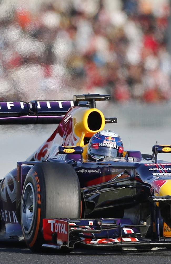 Red Bull driver Sebastian Vettel of Germany steers his car on his way to winning the Japanese Formula One Grand Prix at the Suzuka circuit in Suzuka, Japan, Sunday, Oct. 13, 2013