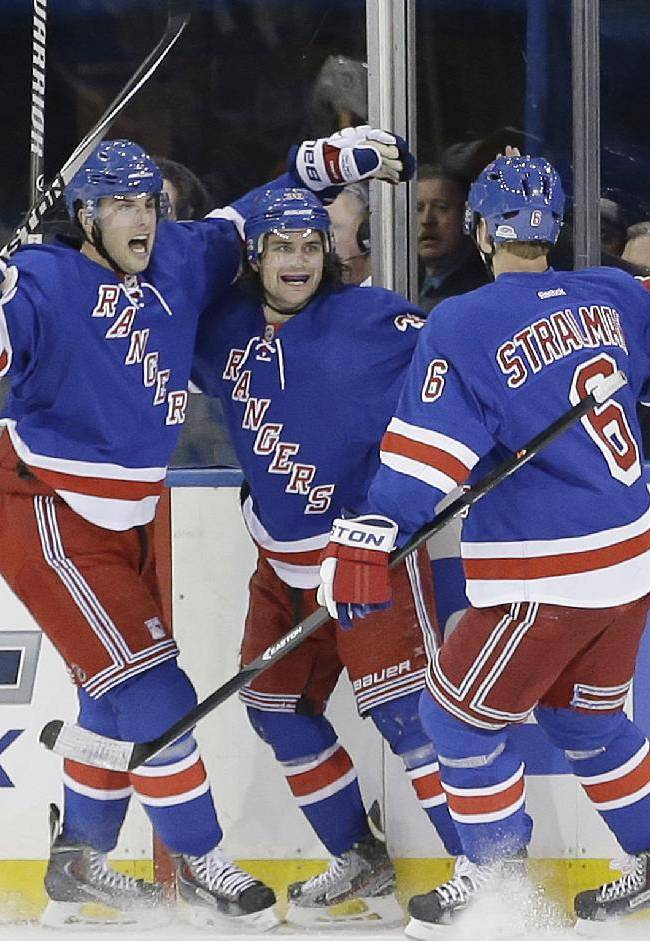 Rangers score 3 in 3rd, top Flyers in opener 4-1