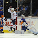 Washington Capitals' Evgeny Kuznetsov (92) celebrates his goal as New York Islanders' Matt Carkner (7) and goalie Evgeni Nabokov (20) react in the second period of an NHL hockey game on Saturday, April 5, 2014, in Uniondale, N.Y The Associated Press