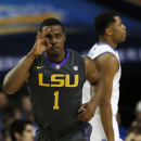 LSU guard Anthony Hickey (1) celebrates his three-pint shot against Kentucky during the first half of an NCAA college basketball game in the quarterfinal round of the Southeastern Conference men's tournament, Friday, March 14, 2014, in Atlanta. (AP Photo/John Bazemore)