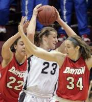 Saint Bonaventure's Megan Van Tatenhove, center, is trapped by Dayton's Casey Nance and Justine Raterman, right, during the first half of an NCAA Atlantic 10 women's college basketball championship game, Monday, March 5, 2012, in Philadelphia. (AP Photo/Tom Mihalek)