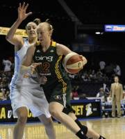 Seattle Storm's Ann Wauters right, drives around Chicago Sky's Ruth Riley during the first quarter of a WNBA basketball game in Rosemont, Ill., June 13, 2012. (AP Photo/Paul Beaty)