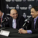 Pete D'Alessandro, center, laughs at a comment made by Vivek Ranadive,right, the new owner of the Sacramento Kings basketball team at a news conference where D'Alessandro was formally introduced as the Kings new general manager in Sacramento, Calif., Monday June 17, 2013. D'Alessandro, who spent the past three seasons with the Denver Nuggets, replaces Geoff Petrie who had been notified that he would not retained after his contract expired June 30. At right is Kings head coach Michael Malone.(AP Photo/Rich Pedroncelli)