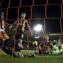 Hull City's goalkeeper Steve Harper, bottom right, dives in vain as Southampton's Jose Fonte, out of frame, scores during their English Premier League soccer match at the KC Stadium, Hull, England, Tuesday Feb. 11, 2014