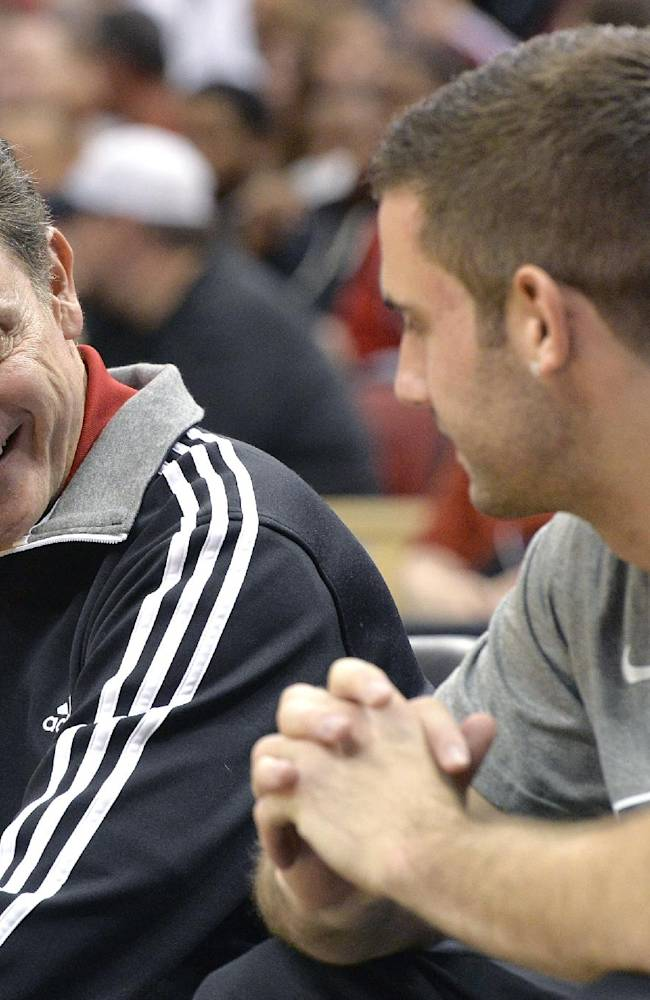 Louisville head coach Rick Pitino, left, shares a laugh with Luke Hancock during an NCAA college basketball scrimmage Saturday, Oct. 19, 2013, in Louisville, Ky