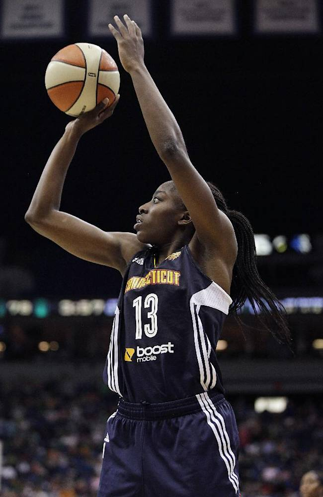Connecticut Sun forward Chiney Ogwumike (13) shoots the ball in the second half of their WNBA basketball game against the Minnesota Lynx , Sunday, May 18, 2014, in Minneapolis. The Lynx won 90-87 in overtime