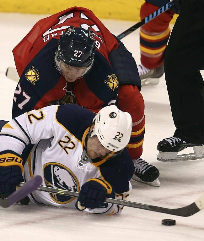 Florida Panthers' Nick Bjudstad (27) and Buffalo Sabres' Johan Larsson (22) battle for the puck during the second period of an NHL hockey game in Sunrise, Fla., Friday, Oct. 25, 2013