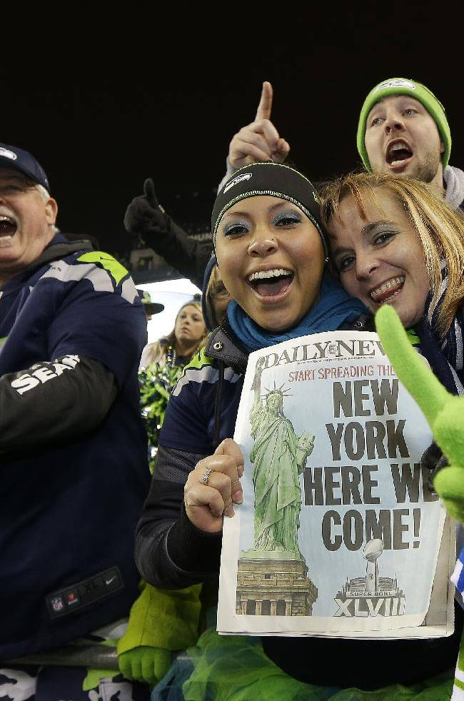 Seattle Seahawks fans celebrate after the NFL football NFC Championship game against the San Francisco 49ers Sunday, Jan. 19, 2014, in Seattle. The Seahawks won 23-17 to advance to Super Bowl XLVIII