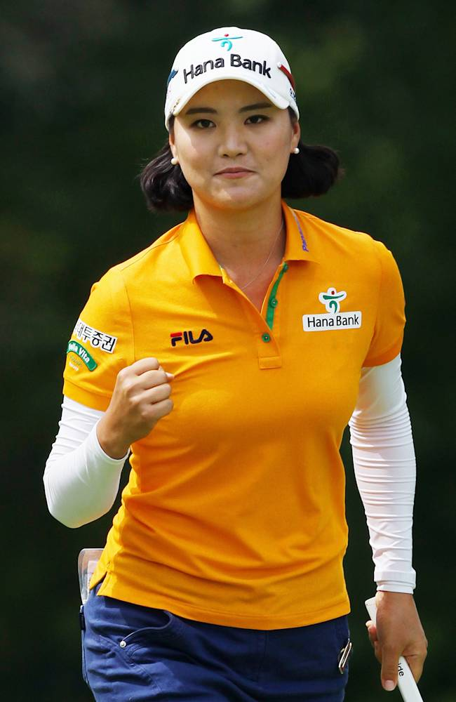So Yeon Ryu, of South Korea, celebrates after sinking her putt for a birdie on the ninth hole during final-round play at the Canadian Pacific Women's Open golf tournament in London, Ontario, Sunday, Aug. 24, 2014