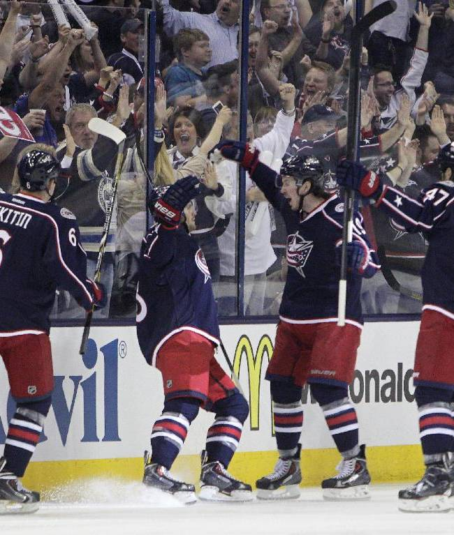 Columbus Blue Jackets' Nikita Nikitin, left to right, of Russia, Boone Jenner, Ryan Johansen and Dalton Prout celebrate their goal against the Pittsburgh Penguins during the first period of a first-round NHL playoff hockey game Monday, April 21, 2014, in Columbus, Ohio