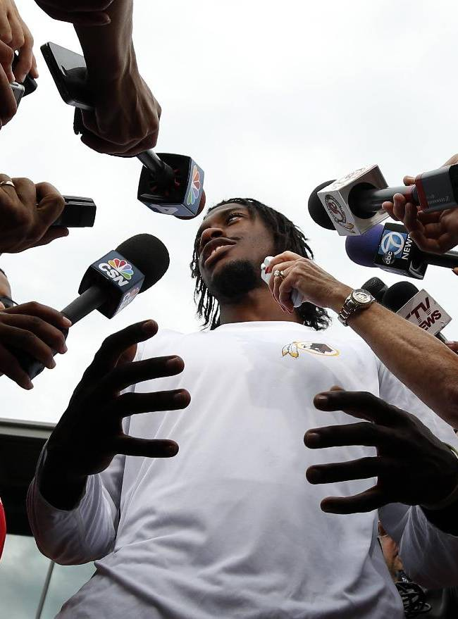 Washington Redskins quarterback Robert Griffin III speaks during a media availability after practice at the team's NFL football training facility, Sunday, July 27, 2014, in Roanoke, Va