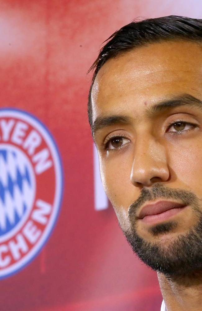 New Bayern Munich player Mehdi Benatia of Marocco, listens during a press conference at the soccer clup headquarters in Munich, Germany on Thursday Aug.28,2014