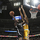 Brooklyn Nets center Andray Blatche, left, goes up for shot as Denver Nuggets forward Anthony Randolph defends during the first quarter of an NBA basketball game in Denver on Thursday, Feb. 27, 2014 The Associated Press