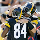Pittsburgh Steelers quarterback Ben Roethlisberger (7) greets wide receiver Antonio Brown (84) after Brown caught a touchdown pass from him in the second quarter of the NFL football game against the Cleveland Browns on Sunday, Sept. 7, 2014 in Pittsburgh