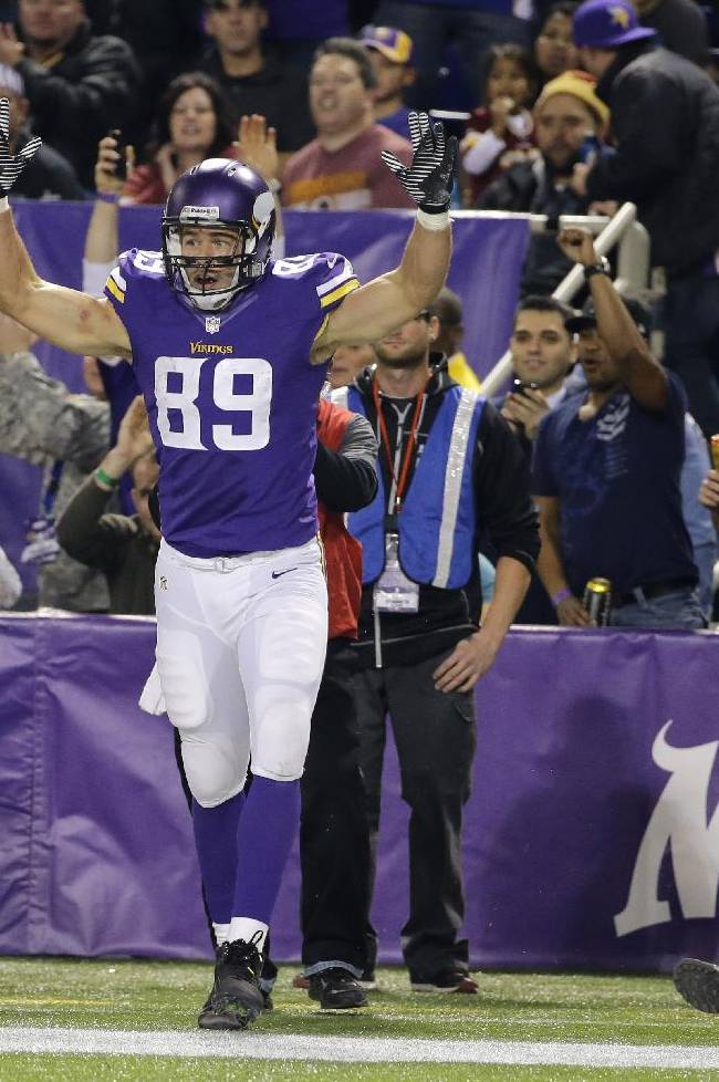 Minnesota Vikings tight end John Carlson reacts after catching a touchdown reception during the second half of an NFL football game against the Washington Redskins, Thursday, Nov. 7, 2013, in Minneapolis