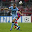 Manchester City's Edin Dzeko reacts during the Champions League Group E soccer match between FC Bayern Munich and Manchester City at Allianz Arena in Munich, southern Germany, Wednesday Sept. 17, 2014