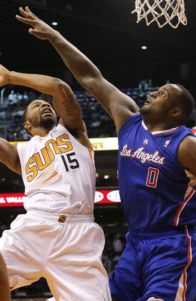 Phoenix Suns' Marcus Morris (15) shoots over  Los Angeles Clippers' Glen Davis (0) during the second half of an NBA basketball game, Tuesday, March 4, 2014, in Phoenix. The Clippers won 104-96
