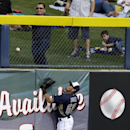 San Diego Padres center fielder Rico Noel is unable to reach an RBI double by Seattle Mariners' Michael Saunders in the fourth inning of an exhibition baseball game, Friday, Feb. 28, 2014, in Peoria, Ariz The Associated Press