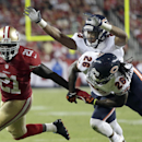 San Francisco 49ers running back Frank Gore (21) runs past Chicago Bears cornerback Tim Jennings (26) and cornerback Kyle Fuller (23) during the third quarter of an NFL football game in Santa Clara, Calif., Sunday, Sept. 14, 2014 The Associated Press