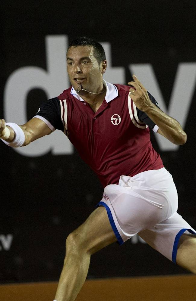 Albert Montanes, of Spain, returns the ball to Rafael Nadal, of Spain, at the Rio Open tennis tournament in Rio de Janeiro, Brazil, Thursday, Feb. 20, 2014