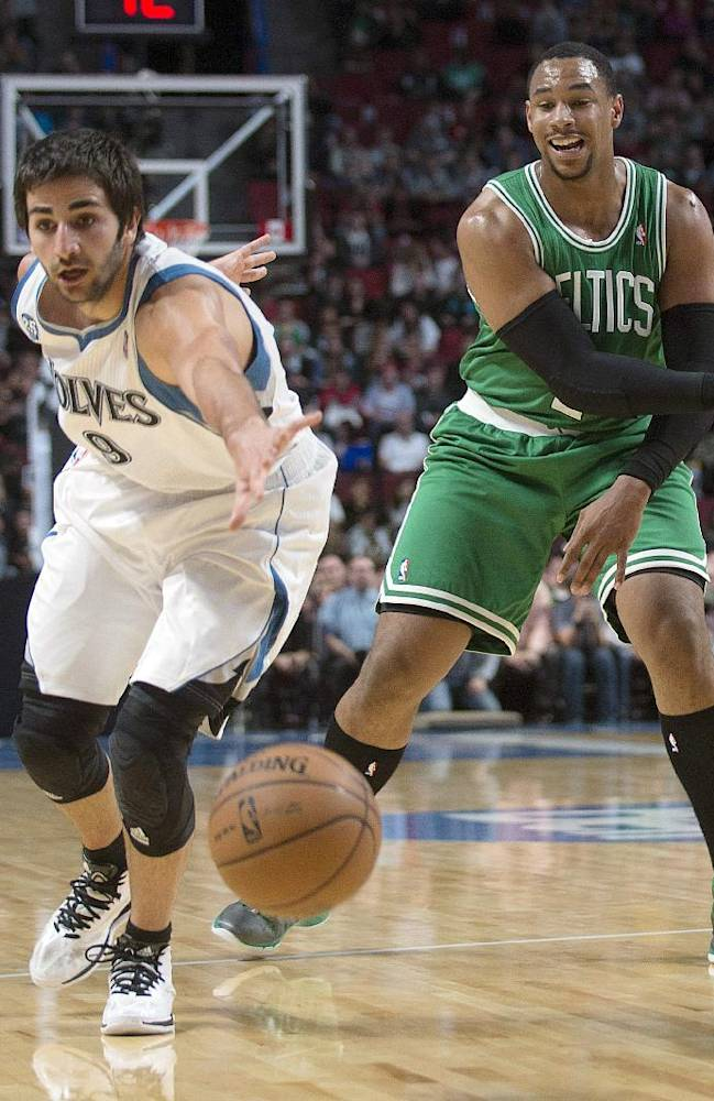 Boston Celtics' Jared Sullinger, right, makes a pass as Minnesota Timberwolves' Ricky Rubio defends during first quarter of an NBA preseason basketball game in Montreal, Sunday, Oct. 20, 2013