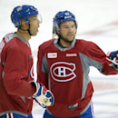 Montreal Canadiens centers Manny Malhotra, left, and David Desharnais go over a play during NHL hockey training camp, Friday, Sept. 19, 2014, in Brossard, Quebec The Associated Press