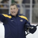 In this photo taken, Jan. 14, 2013, Nashville Predators associate coach Peter Horachek gestures during an NHL hockey practice