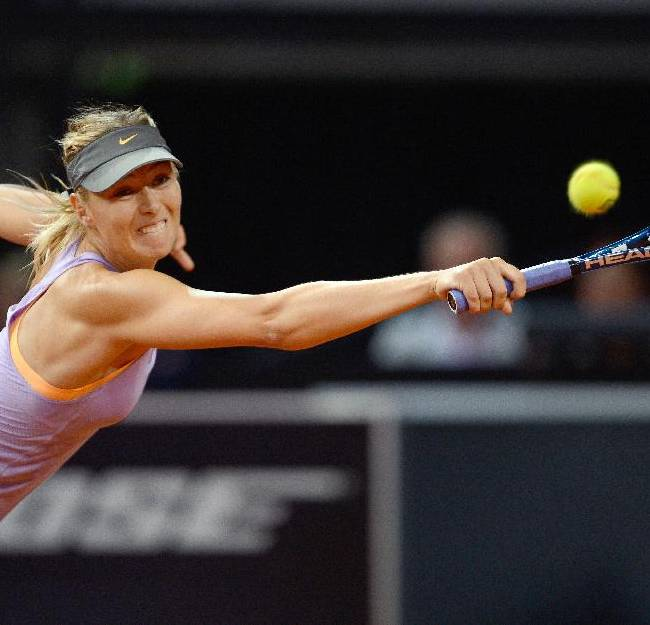 Russia's Maria Sharapova returns the ball to Serbia's Ana Ivanovic during their final match at the Porsche tennis Grand Prix in Stuttgart, Germany, Sunday, April 27, 2014