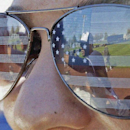 Milwaukee Brewers' Carlos Gomez is reflected in the sunglasses of fan Morgan Hinke as he signs autographs before an exhibition spring training baseball game against the Chicago Cubs Monday, March 3, 2014, in Phoenix The Associated Press