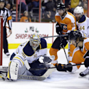 Buffalo Sabres' Ryan Miller (30) blocks a shot by Philadelphia Flyers' Claude Giroux (28) as Jakub Voracek (93), of Czech Republic, Brayden McNabb (44) and Mikhail Grigorenko (25), of Russia, stand by during the second period of an NHL hockey game Thursda