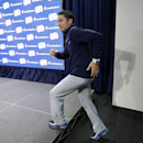 New England Revolution manager Jay Heaps steps onto the podium before taking questions from reporters during a media availability at the MLS Soccer team's facility, Wednesday, Dec. 3, 2014 in Foxborough, Mass. Los Angeles Galaxy will play the New England