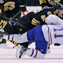 Boston Bruins center David Krejci (46) checks Montreal Canadiens right wing Brendan Gallagher (11) to the ice during the second period of an NHL hockey game, Monday, March 24, 2014, in Boston The Associated Press