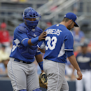 Kansas City Royals catcher Salvador Perez talks with starting pitcher James Shields during the first inning of a spring exhibition baseball game against the San Diego Padres Wednesday, March 26, 2014, in Peoria, Ariz The Associated Press