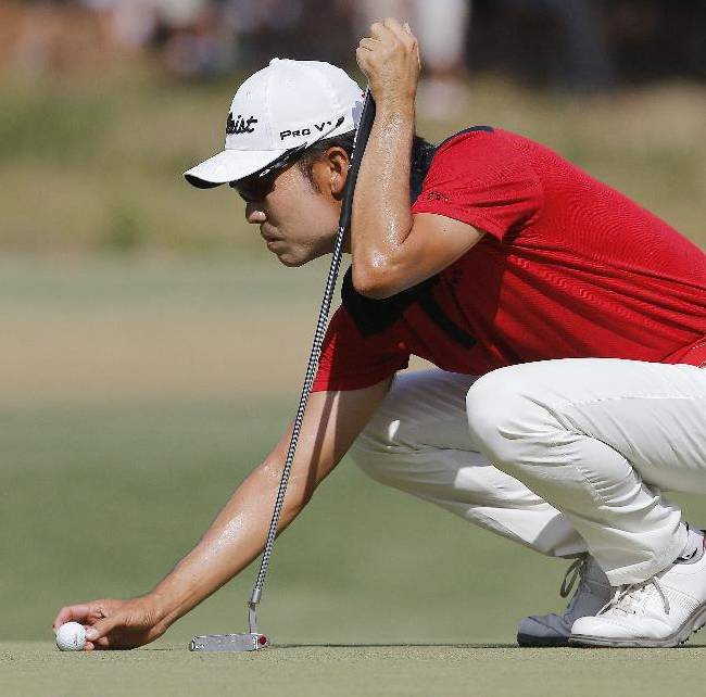 Kevin Na lines up his putt on the seventh hole during the third round of the U.S. Open golf tournament in Pinehurst, N.C., Saturday, June 14, 2014