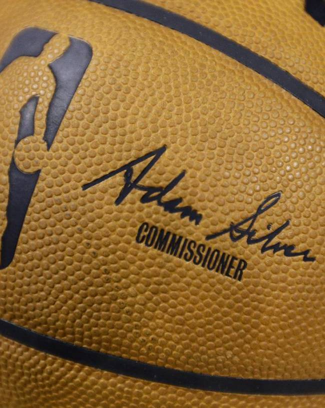 An NBA game ball featuring the signature of new NBA Commissioner Adam Silver is shown before a basketball game between the Indiana Pacers and the Brooklyn Nets in Indianapolis, Saturday, Feb. 1, 2014. David Stern retired after exactly 30 years in charge, making him the NBA's longest-serving and most successful commissioner
