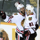 Chicago Blackhawks right wing Marian Hossa (81), of Slovakia, celebrates with Brandon Saad (20) after Hossa scored a goal against the Nashville Predators in the second period of an NHL hockey game Saturday, Dec. 6, 2014, in Nashville, Tenn The Associated